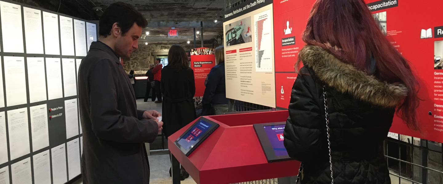 Visitors using Eastern State Penitentiary Prisons Today Interactives